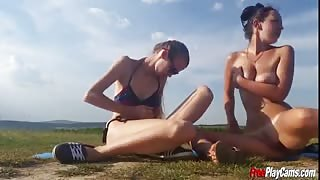 Two Hot European Teens Masturbate Outdoors in a Public Field
