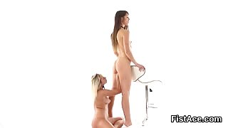 Lesbo bent over a chair and pussy fisted